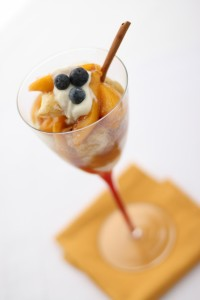 Cinnamon Ice Cream topped with Peaches and Berries